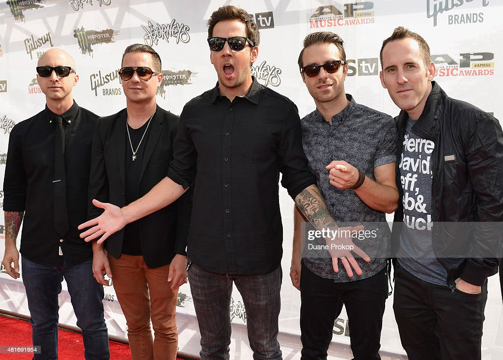 Jeff Stinco David Desrosiers Pierre Bouvier Sébastien Lefebvre and Chuck Comeau of Simple Plan attend the 2015 Journeys AP Music Awards Fueled by...