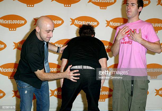 Jeff Stinco Pierre Bouvier and Chuck Comeau of Simple Plan pose in the press room at the 18th Annual Kids Choice Awards at UCLA's Pauley Pavillion on...