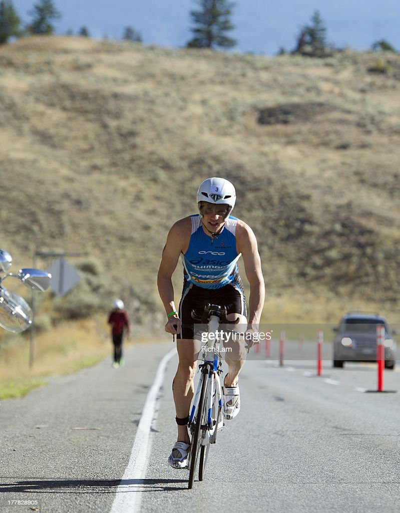 Jeff Symonds climbs Richter Pass during the Challenge Penticton Triathlon on August 25, 2013 in Penticton, British Columbia, Canada.