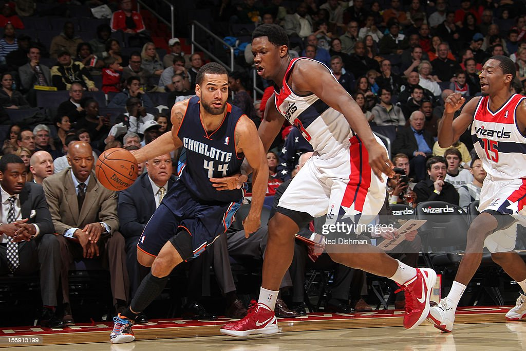 Jeff Taylor #44 of the Charlotte Bobcats drives against <a gi-track='captionPersonalityLinkClicked' href=/galleries/search?phrase=Kevin+Seraphin&family=editorial&specificpeople=6474998 ng-click='$event.stopPropagation()'>Kevin Seraphin</a> #13 of the Washington Wizards during the game at the Verizon Center on November 24, 2012 in Washington, DC.