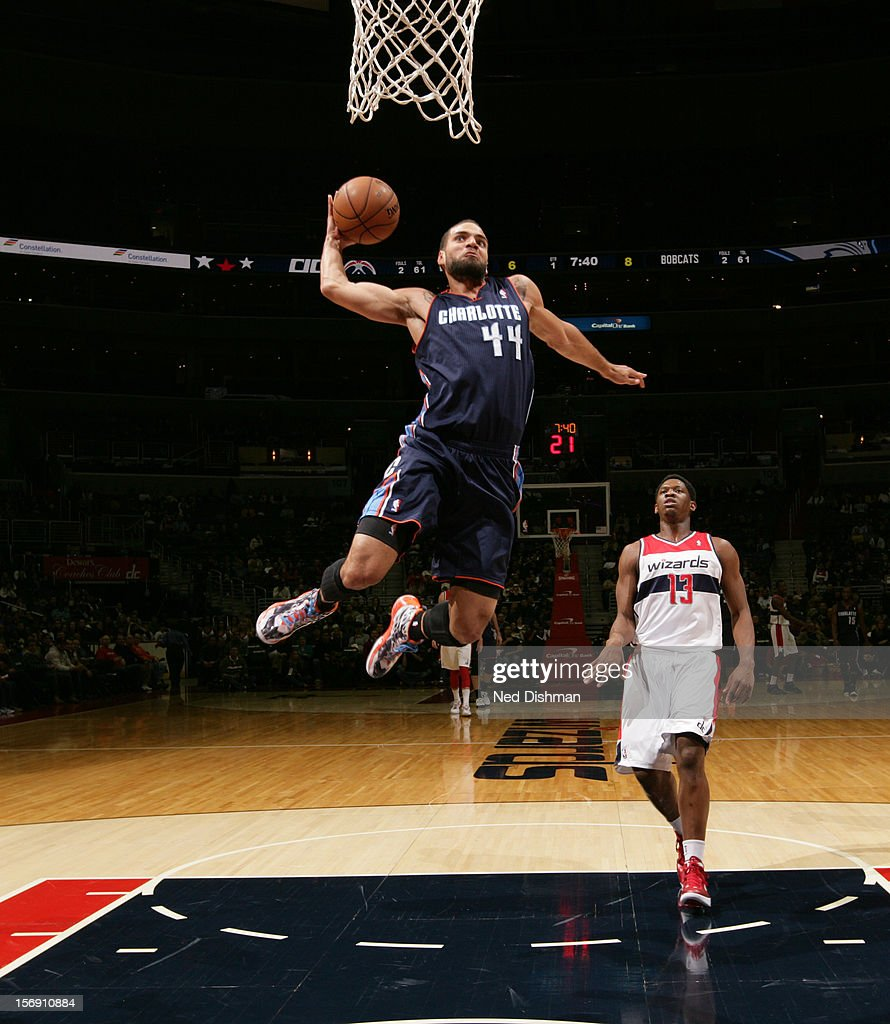 Jeff Taylor #44 of the Charlotte Bobcats dunks against Kevin Seraphin #13 of the Washington Wizards during the game at the Verizon Center on November 24, 2012 in Washington, DC.