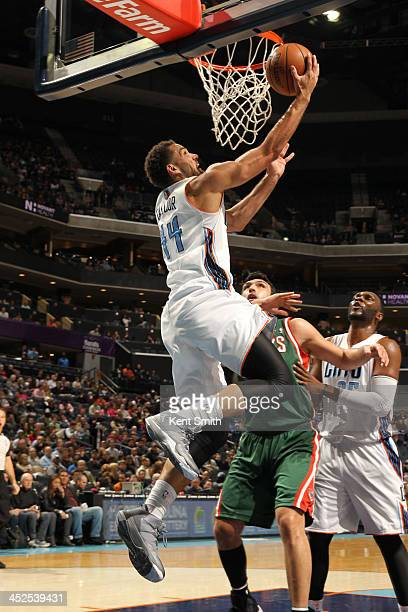 Jeff Taylor of the Charlotte Bobcats shoots against the Milwaukee Bucks during the game at the Time Warner Cable Arena on November 29 2013 in...