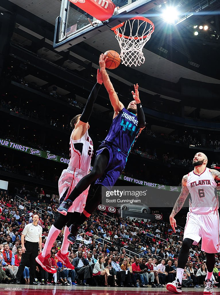 Jeff Taylor of the Charlotte Hornets goes for the layup against the Atlanta Hawks during the game on April 10 2015 at Philips Arena in Atlanta...