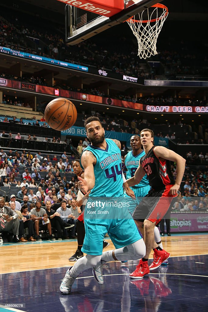 Jeff Taylor of the Charlotte Hornets goes for the loose ball against the Toronto Raptors during the game at the Time Warner Cable Arena on April 8...