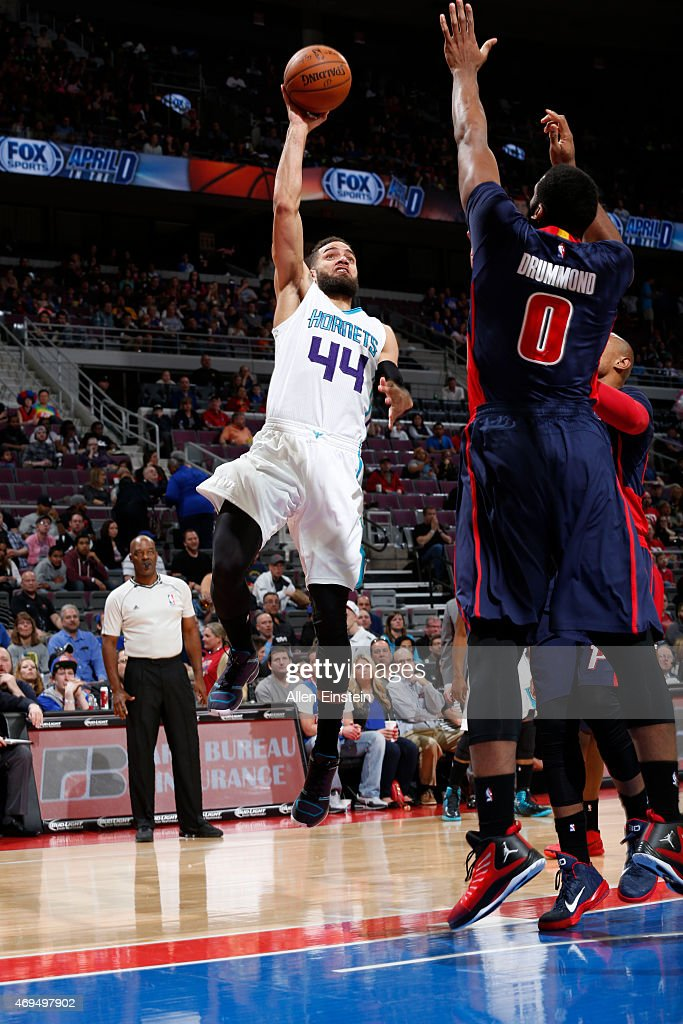 Jeff Taylor of the Charlotte Hornets shoots against Andre Drummond of the Detroit Pistons during the game on April 12 2015 at The Palace of Auburn in...