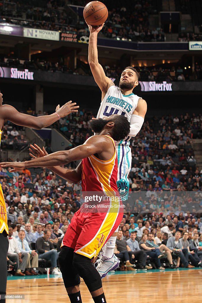 Jeff Taylor of the Charlotte Hornets shoots against James Harden of the Houston Rockets during the game at the Time Warner Cable Arena on April 13...