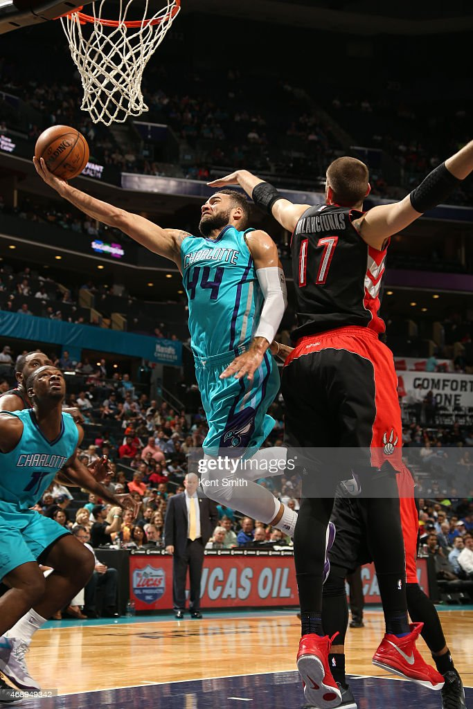 Jeff Taylor of the Charlotte Hornets shoots against Jonas Valanciunas of the Toronto Raptors during the game at the Time Warner Cable Arena on April...