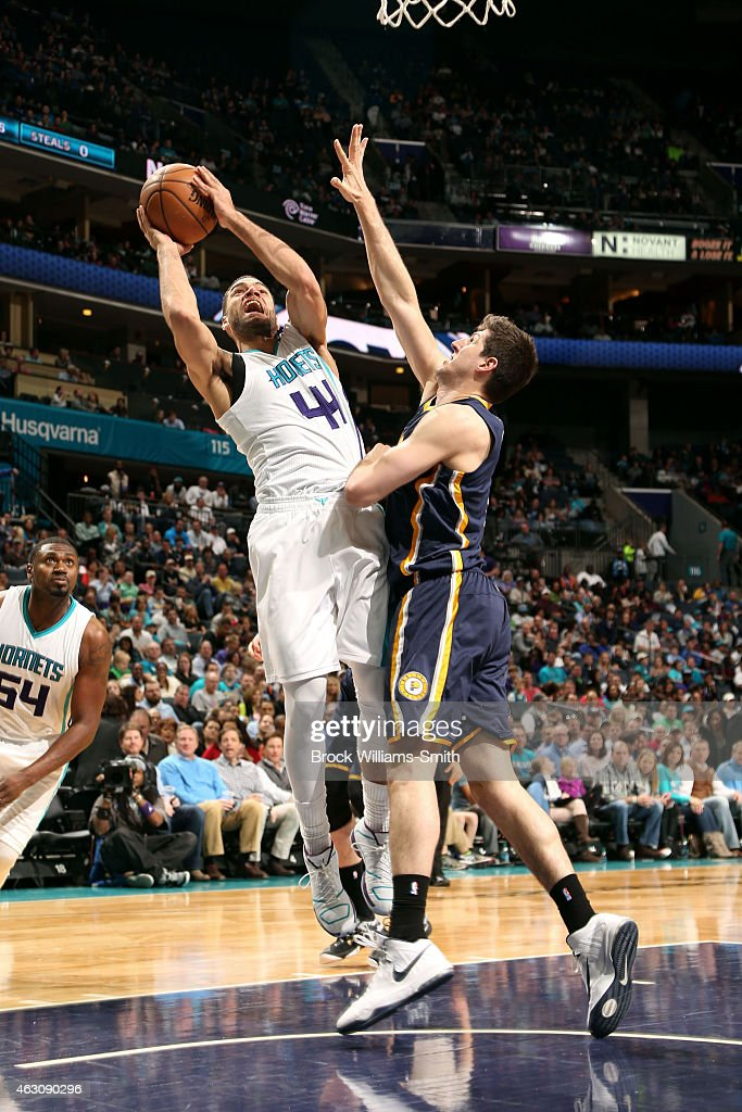 Jeff Taylor #44 of the Charlotte Hornets shoots against Shayne Whittington #42 of the Indiana Pacers during the game at the Time Warner Cable Arena on February 8, 2015 in Charlotte, North Carolina.