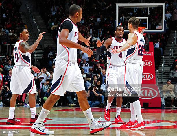 Jeff Teague Al Horford Paul Millsap and Kyle Korver of the Atlanta Hawks celebrate after a score against the Indiana Pacers on January 21 2015 at...