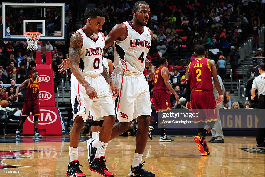<a gi-track='captionPersonalityLinkClicked' href=/galleries/search?phrase=Jeff+Teague&family=editorial&specificpeople=4680498 ng-click='$event.stopPropagation()'>Jeff Teague</a> #0 and <a gi-track='captionPersonalityLinkClicked' href=/galleries/search?phrase=Paul+Millsap&family=editorial&specificpeople=880017 ng-click='$event.stopPropagation()'>Paul Millsap</a> #4 of the Atlanta Hawks walk off the court during the game against the Cleveland Cavaliers on December 6, 2013 at Philips Arena in Atlanta, Georgia.