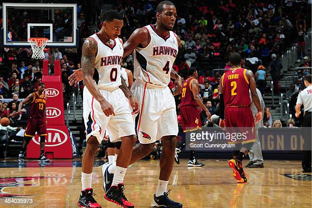 Jeff Teague and Paul Millsap of the Atlanta Hawks walk off the court during the game against the Cleveland Cavaliers on December 6 2013 at Philips...