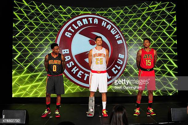 Jeff Teague Kyle Korver and Kent Bazemore of the Atlanta Hawks model the Hawks new uniform on June 24 2015 at Philips Arena in Atlanta Georgia NOTE...