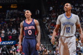 Jeff Teague of the Atlanta Hawks and Marquis Teague of the Brooklyn Nets during a game on April 11 2014 at the Barclays Center in Brooklyn New York...