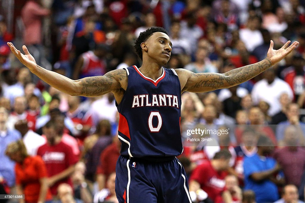 Jeff Teague of the Atlanta Hawks celebrates after hitting a shot against the Washington Wizards during the second half in Game Four of the Eastern...
