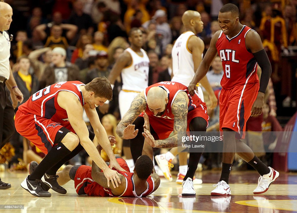 <a gi-track='captionPersonalityLinkClicked' href=/galleries/search?phrase=Jeff+Teague&family=editorial&specificpeople=4680498 ng-click='$event.stopPropagation()'>Jeff Teague</a> #0 of the Atlanta Hawks celebrates on the court with <a gi-track='captionPersonalityLinkClicked' href=/galleries/search?phrase=Kyle+Korver&family=editorial&specificpeople=202504 ng-click='$event.stopPropagation()'>Kyle Korver</a> #26, Pero Antic #6 and <a gi-track='captionPersonalityLinkClicked' href=/galleries/search?phrase=Shelvin+Mack&family=editorial&specificpeople=5767272 ng-click='$event.stopPropagation()'>Shelvin Mack</a> #8 after scoring the game winning basket in double overtime against the Cleveland Cavaliers at Quicken Loans Arena on December 26, 2013 in Cleveland, Ohio.
