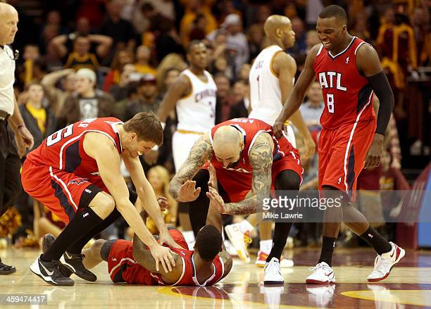 Jeff Teague of the Atlanta Hawks celebrates on the court with Kyle Korver Pero Antic and Shelvin Mack after scoring the game winning basket in double...