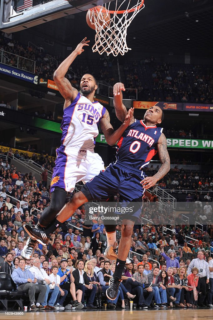 Jeff Teague #0 of the Atlanta Hawks commits a flagrant foul on Marcus Morris #15 of the Phoenix Suns on March 1, 2013 at U.S. Airways Center in Phoenix, Arizona.