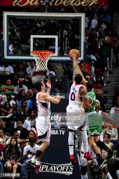 Jeff Teague of the Atlanta Hawks contests a layup attempt by Avery Bradley of the Boston Celtics in Game Two of the Eastern Conference Quarterfinals...