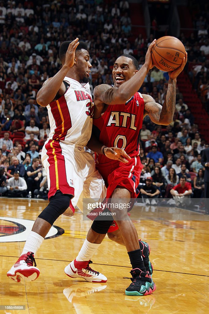 Jeff Teague #0 of the Atlanta Hawks controls the ball against Norris Cole #30 of the Miami Heat during a game on December 10, 2012 at American Airlines Arena in Miami, Florida.