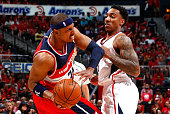 Jeff Teague of the Atlanta Hawks defends against Paul Pierce of the Washington Wizards during Game One of the Eastern Conference Semifinals of the...