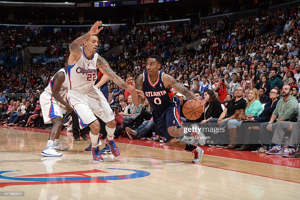 Jeff Teague #0 of the Atlanta Hawks dribbles against Matt Barnes #22 of the Los Angeles Clippers at Staples Center on March 8, 2014 in Los Angeles, California.