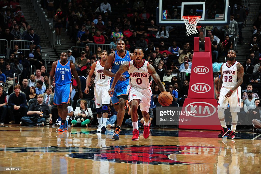 <a gi-track='captionPersonalityLinkClicked' href=/galleries/search?phrase=Jeff+Teague&family=editorial&specificpeople=4680498 ng-click='$event.stopPropagation()'>Jeff Teague</a> #0 of the Atlanta Hawks dribbles the ball up court against the Oklahoma City Thunder at Philips Arena on December 19 ,2012 in Atlanta, Georgia.