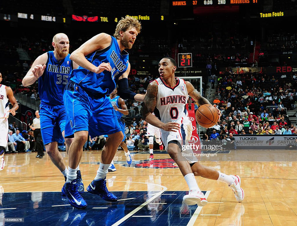Jeff Teague #0 of the Atlanta Hawks dribbles the ball up the court against Dirk Nowitzki #41 of the Dallas Mavericks on March 18, 2013 at Philips Arena in Atlanta, Georgia.