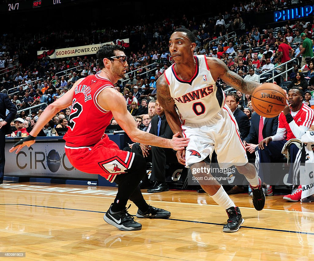 Jeff Teague #0 of the Atlanta Hawks drives against Kirk Hinrich #12 of the Chicago Bulls on April 2, 2014 at Philips Arena in Atlanta, Georgia.
