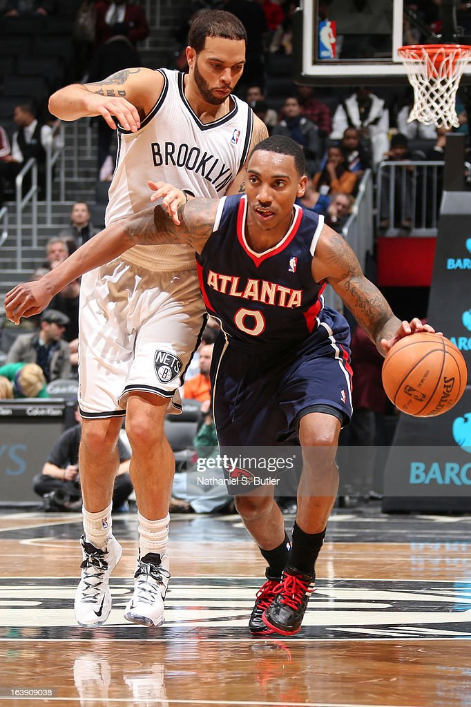 Jeff Teague #0 of the Atlanta Hawks drives ahead of Deron Williams #8 of the Brooklyn Nets on March 17, 2013 at the Barclays Center in the Brooklyn borough of New York City.