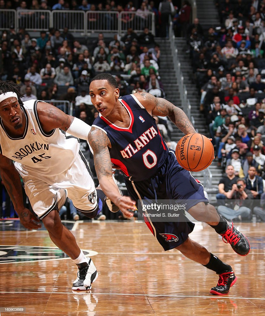 Jeff Teague #0 of the Atlanta Hawks drives ahead of Gerald Wallace #45 of the Brooklyn Nets on March 17, 2013 at the Barclays Center in the Brooklyn borough of New York City.