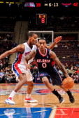 Jeff Teague of the Atlanta Hawks drives ahead of Kim English of the Detroit Pistons on February 25 2013 at The Palace of Auburn Hills in Auburn Hills...