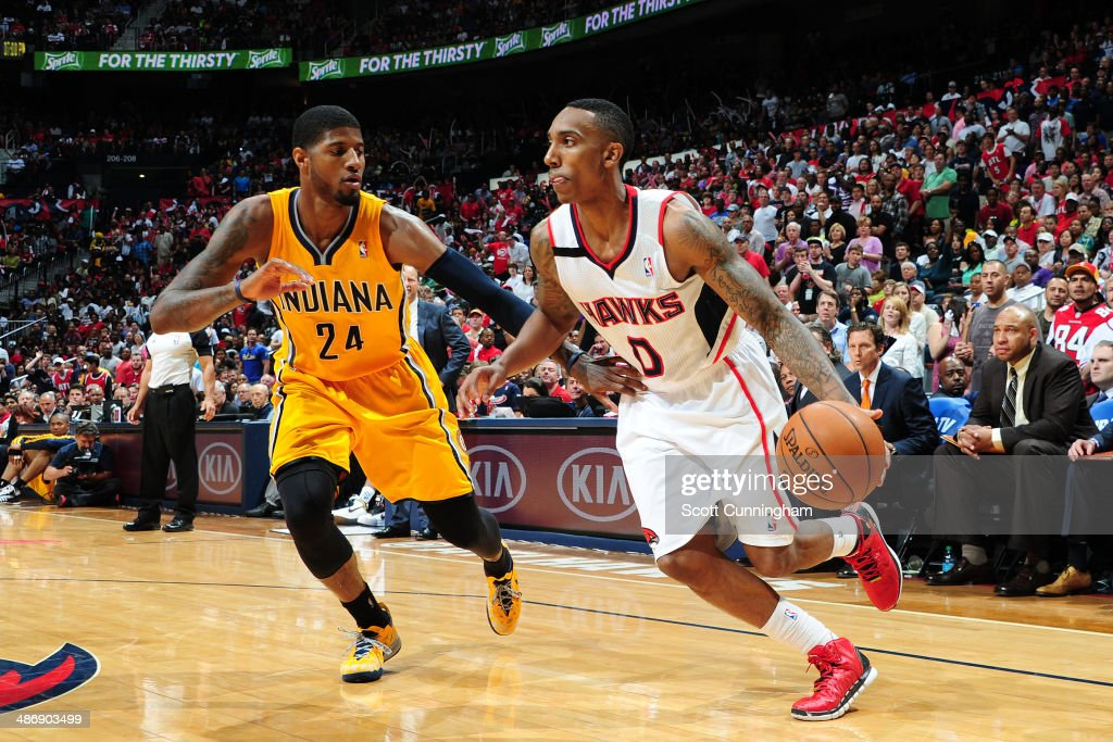 <a gi-track='captionPersonalityLinkClicked' href=/galleries/search?phrase=Jeff+Teague&family=editorial&specificpeople=4680498 ng-click='$event.stopPropagation()'>Jeff Teague</a> #0 of the Atlanta Hawks drives baseline against the Indiana Pacers during Game Four of the Eastern Conference Quarterfinals on April 26, 2014 at Philips Arena in Atlanta, Georgia.