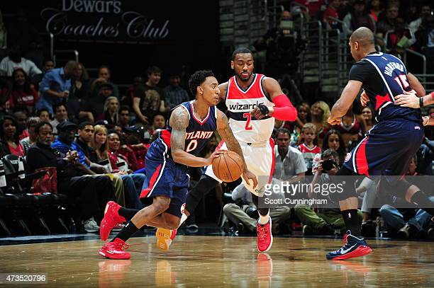 Jeff Teague of the Atlanta Hawks drives to the basket against John Wall of the Washington Wizards in Game Six of the Eastern Conference Semifinals...