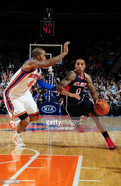 Jeff Teague of the Atlanta Hawks drives to the basket against JR Smith of the New York Knicks during the game on February 22 2012 at Madison Square...