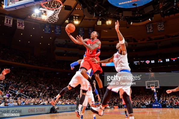 Jeff Teague of the Atlanta Hawks drives to the basket against JR Smith of the New York Knicks at Madison Square Garden on January 27 2013 in New York...