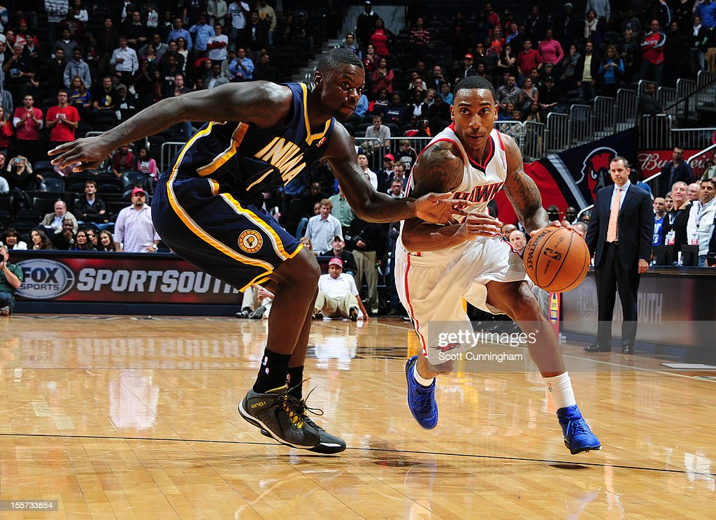 <a gi-track='captionPersonalityLinkClicked' href=/galleries/search?phrase=Jeff+Teague&family=editorial&specificpeople=4680498 ng-click='$event.stopPropagation()'>Jeff Teague</a> of the Atlanta Hawks drives to the basket against <a gi-track='captionPersonalityLinkClicked' href=/galleries/search?phrase=Lance+Stephenson&family=editorial&specificpeople=5298304 ng-click='$event.stopPropagation()'>Lance Stephenson</a> #1 of the Indiana Pacers at Philips Arena on November 7, 2012 in Atlanta, Georgia.