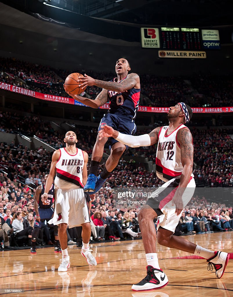 <a gi-track='captionPersonalityLinkClicked' href=/galleries/search?phrase=Jeff+Teague&family=editorial&specificpeople=4680498 ng-click='$event.stopPropagation()'>Jeff Teague</a> #0 of the Atlanta Hawks drives to the basket against <a gi-track='captionPersonalityLinkClicked' href=/galleries/search?phrase=LaMarcus+Aldridge&family=editorial&specificpeople=453277 ng-click='$event.stopPropagation()'>LaMarcus Aldridge</a> #12 of the Portland Trail Blazers on November 12, 2012 at the Rose Garden Arena in Portland, Oregon.