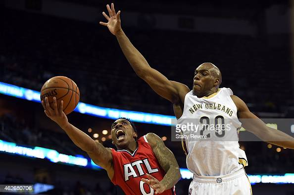 Jeff Teague of the Atlanta Hawks drives to the basket against Quincy Pondexter of the New Orleans Pelicans during the first half of a game at the...
