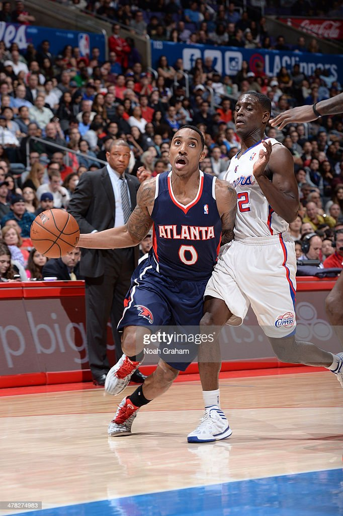 Jeff Teague #0 of the Atlanta Hawks drives to the basket against the Los Angeles Clippers at Staples Center on March 8, 2014 in Los Angeles, California.