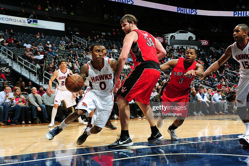 <a gi-track='captionPersonalityLinkClicked' href=/galleries/search?phrase=Jeff+Teague&family=editorial&specificpeople=4680498 ng-click='$event.stopPropagation()'>Jeff Teague</a> #0 of the Atlanta Hawks drives to the basket against the Toronto Raptors on January 30, 2013 at Philips Arena in Atlanta, Georgia.