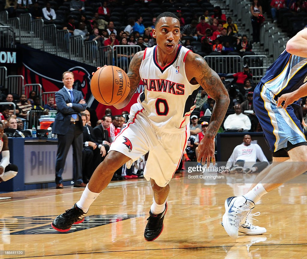 <a gi-track='captionPersonalityLinkClicked' href=/galleries/search?phrase=Jeff+Teague&family=editorial&specificpeople=4680498 ng-click='$event.stopPropagation()'>Jeff Teague</a> #0 of the Atlanta Hawks drives to the basket against the Memphis Grizzlies on October 20, 2013 at Philips Arena in Atlanta, Georgia.