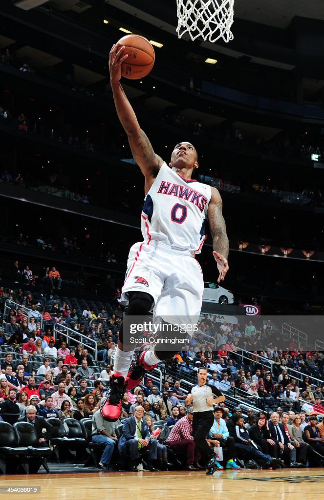 <a gi-track='captionPersonalityLinkClicked' href=/galleries/search?phrase=Jeff+Teague&family=editorial&specificpeople=4680498 ng-click='$event.stopPropagation()'>Jeff Teague</a> #0 of the Atlanta Hawks drives to the basket against the Cleveland Cavaliers on December 6, 2013 at Philips Arena in Atlanta, Georgia.