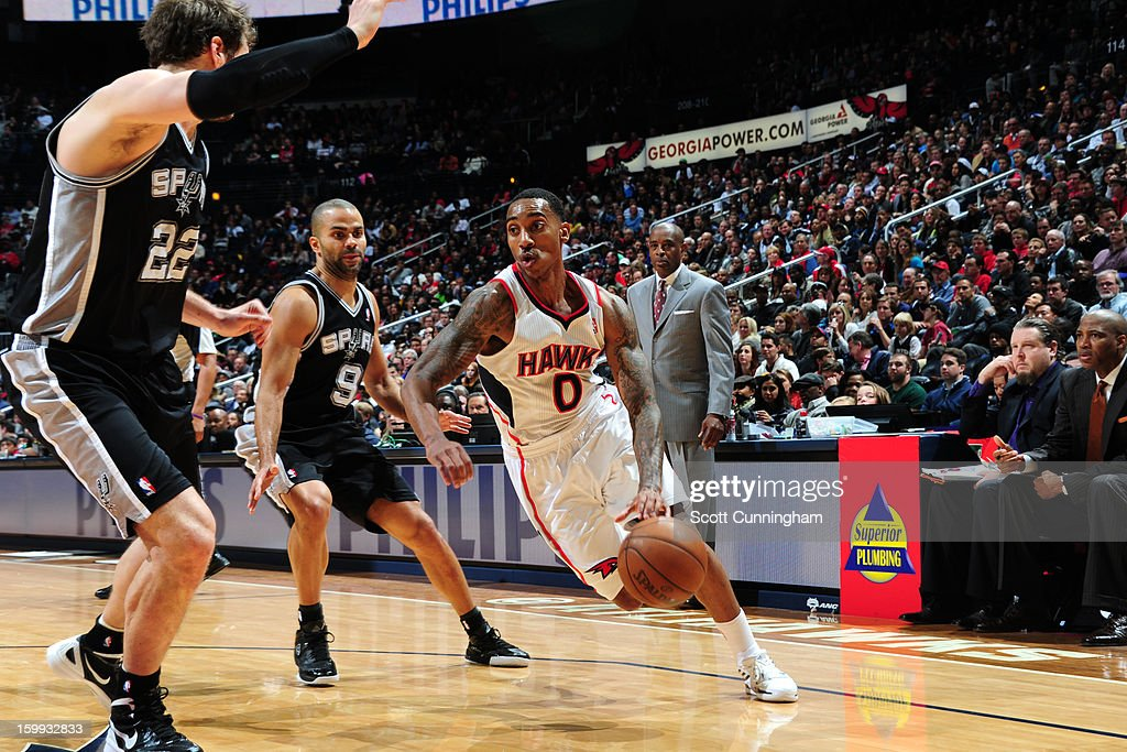 <a gi-track='captionPersonalityLinkClicked' href=/galleries/search?phrase=Jeff+Teague&family=editorial&specificpeople=4680498 ng-click='$event.stopPropagation()'>Jeff Teague</a> #0 of the Atlanta Hawks drives to the basket against the San Antonio Spurs on January 19, 2013 at Philips Arena in Atlanta, Georgia.
