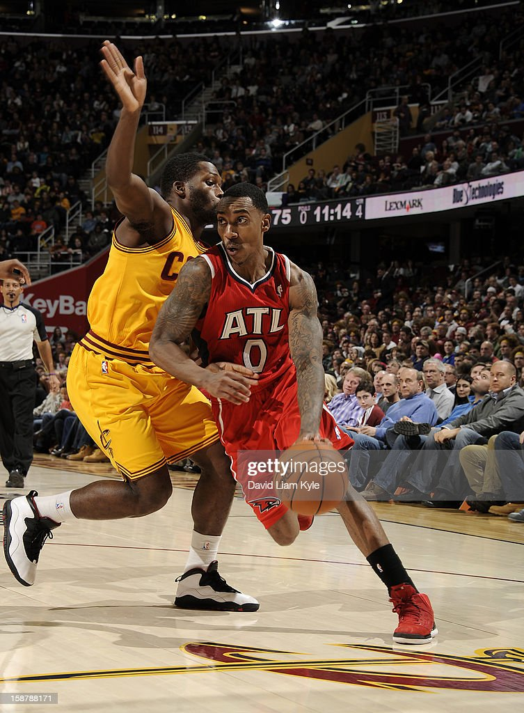 Jeff Teague #0 of the Atlanta Hawks drives to the hoop against Jeremy Pargo #8 of the Cleveland Cavaliers at The Quicken Loans Arena on December 28, 2012 in Cleveland, Ohio.