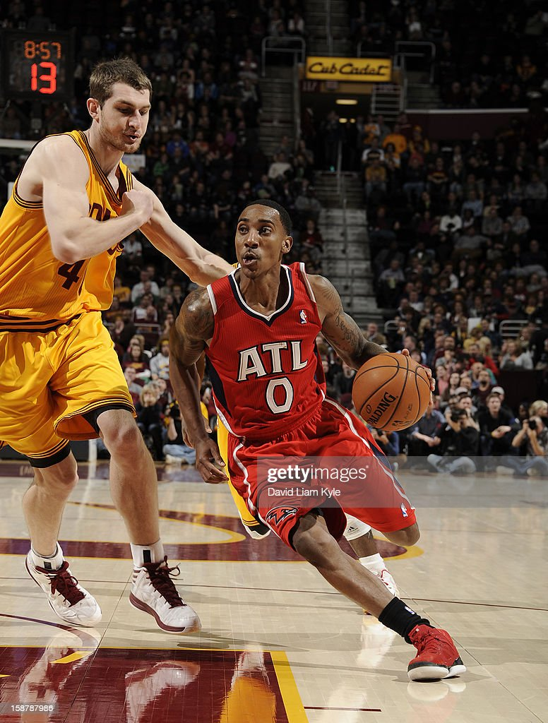 Jeff Teague #0 of the Atlanta Hawks drives to the hoop against Tyler Zeller #40 of the Cleveland Cavaliers at The Quicken Loans Arena on December 28, 2012 in Cleveland, Ohio.