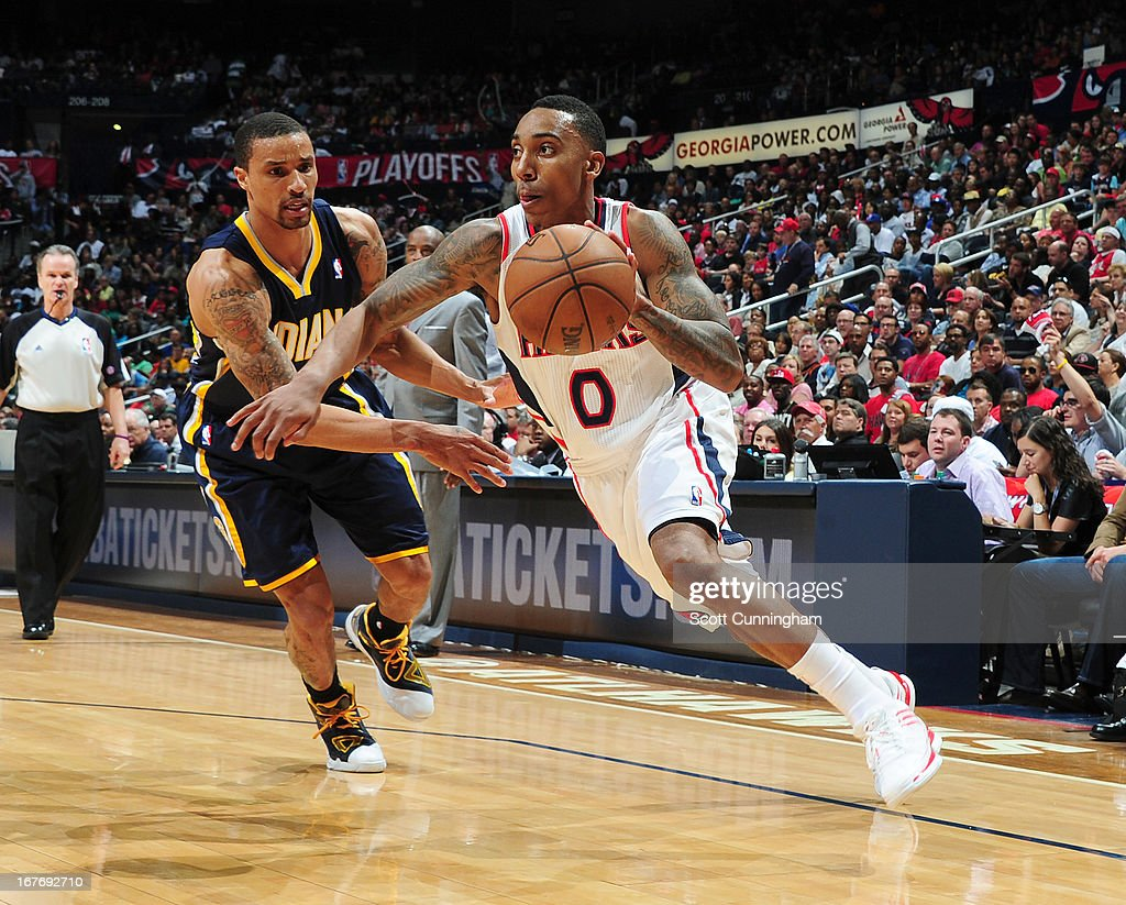 Jeff Teague #0 of the Atlanta Hawks drives under pressure from George Hill #3 of the Indiana Pacers during the Game Three of the Eastern Conference Quarterfinals between the Indiana Pacers and the Atlanta Hawks in the 2013 NBA Playoffs on April 27, 2013 at Philips Arena in Atlanta, Georgia.