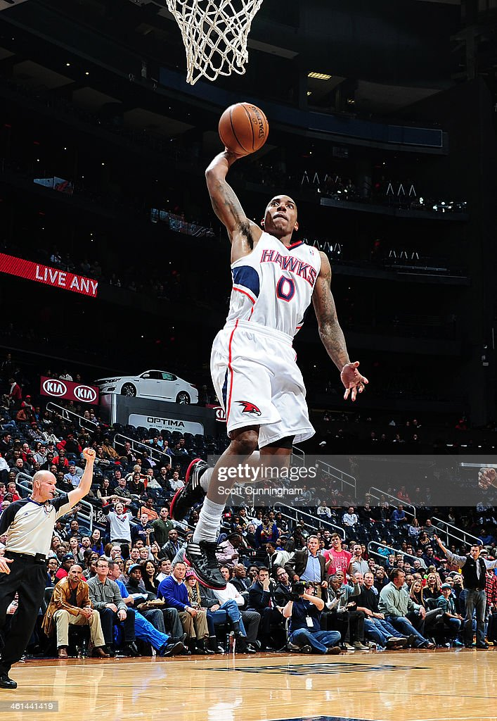 <a gi-track='captionPersonalityLinkClicked' href=/galleries/search?phrase=Jeff+Teague&family=editorial&specificpeople=4680498 ng-click='$event.stopPropagation()'>Jeff Teague</a> #0 of the Atlanta Hawks dunking during a game against the Indiana Pacers of the Atlanta Hawks against of the Indiana Pacers on January 8, 2014 at Philips Arena in Atlanta, Georgia.