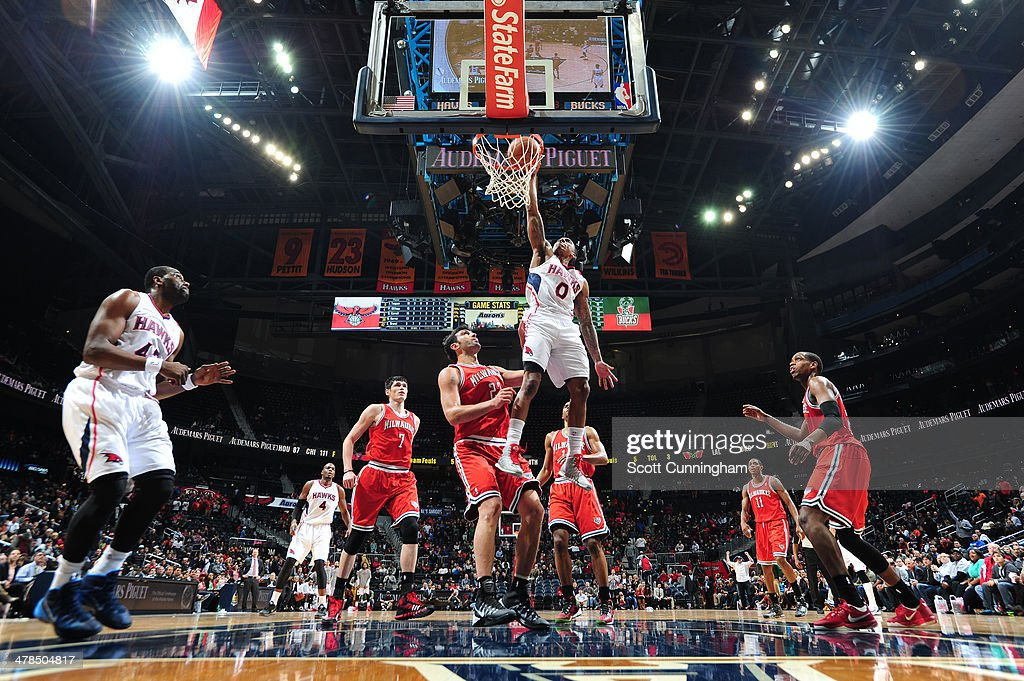 <a gi-track='captionPersonalityLinkClicked' href=/galleries/search?phrase=Jeff+Teague&family=editorial&specificpeople=4680498 ng-click='$event.stopPropagation()'>Jeff Teague</a> #0 of the Atlanta Hawks dunks against the Milwaukee Bucks on March 13, 2014 at Philips Arena in Atlanta, Georgia.