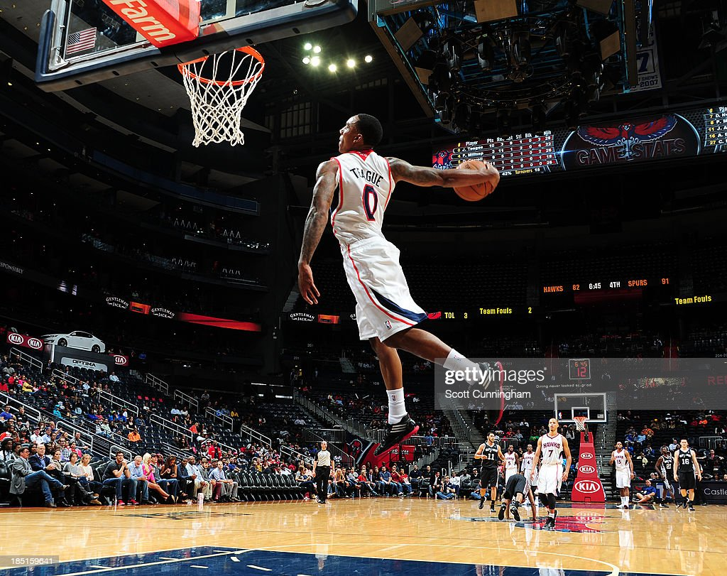 <a gi-track='captionPersonalityLinkClicked' href=/galleries/search?phrase=Jeff+Teague&family=editorial&specificpeople=4680498 ng-click='$event.stopPropagation()'>Jeff Teague</a> #0 of the Atlanta Hawks dunks against the San Antonio Spurs on October 17, 2013 at Philips Arena in Atlanta, Georgia.