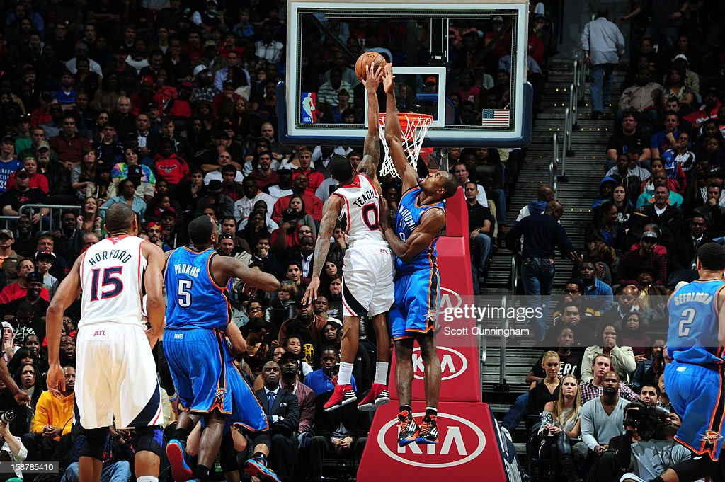 <a gi-track='captionPersonalityLinkClicked' href=/galleries/search?phrase=Jeff+Teague&family=editorial&specificpeople=4680498 ng-click='$event.stopPropagation()'>Jeff Teague</a> #0 of the Atlanta Hawks dunks the ball against the Oklahoma City Thunder at Philips Arena on December 19 ,2012 in Atlanta, Georgia.